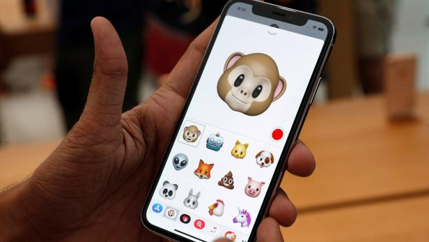A man tries out the Animoji feature on the iPhone