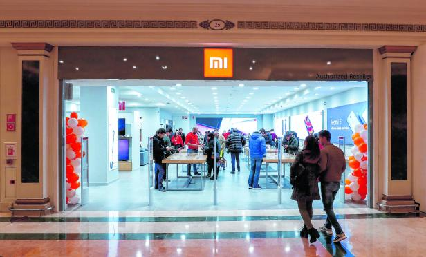 Customers enter a Xiaomi shop in a shopping mall in Barcelona