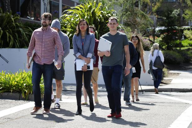 YouTube employees are seen walking away from Youtube headquarters following an active shooter situation in San Bruno, California