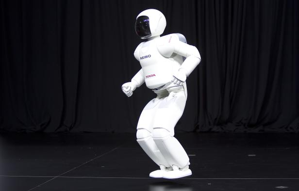 Honda Motor's Asimo robot demonstrates its ability to hop during a demonstration for the media at the Jacob Javits Convention Center during the New York International Auto Show in New York