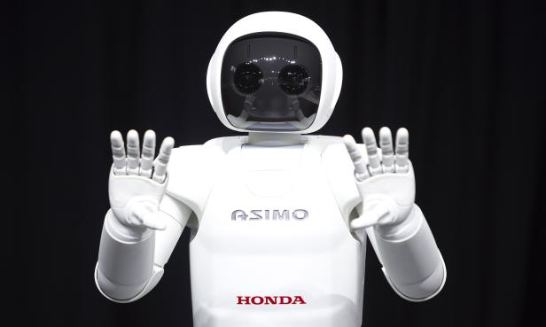 Honda Motor's Asimo robot puts on a demonstration for the media at the Jacob Javits Convention Center during the New York International Auto Show in New York