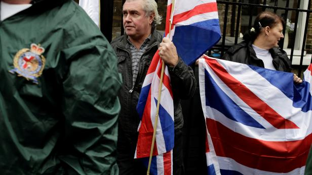 People hold the Union Flag whilst attending a Britain First rally in Rochester