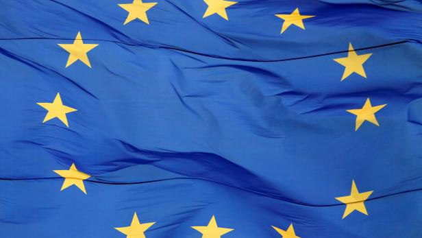 An EU flag is seen blowing in the wind in front of the city's regional state administration headquarters in Kiev