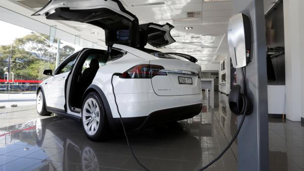A Tesla wall connector demonstrates the charging at home of a Model X vehicle at a Tesla electric car dealership in Sydney