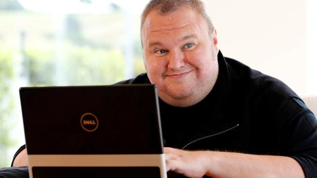FILE PHOTO: Kim Dotcom smiles during an interview with Reuters in Auckland