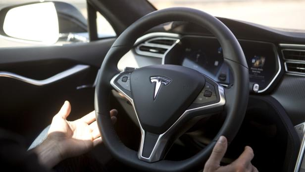 New Autopilot features are demonstrated in a Tesla Model S during a Tesla event in Palo Alto