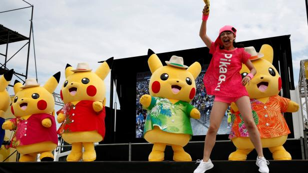FILE PHOTO: Performers in Pikachu costumes dance at a Splash show and Pokemon Go Park event in Yokohama