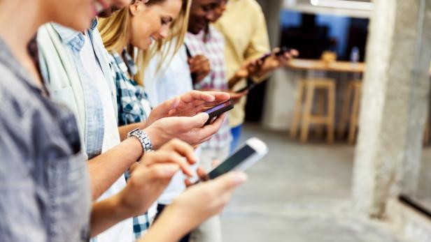 Group of people using their smart phones