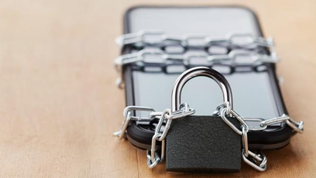 Smartphone tied chain with lock, digital devices detox concept