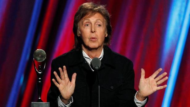 FILE PHOTO - Paul McCartney speaks as he inducts Ringo Starr during the 2015 Rock and Roll Hall of Fame Induction Ceremony in Cleveland