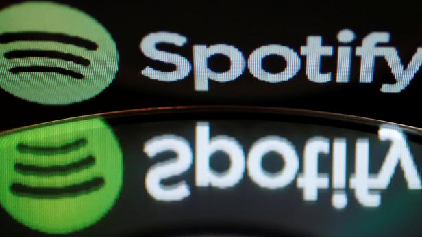 Illustration picture of the logo of online music streaming service Spotify reflected in an audio music CD