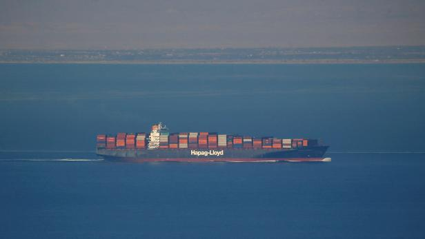 FILE PHOTO: A Hapag Lloyd container ship sails across the Gulf of Suez Canal, in El Ain El Sokhna in Suez, east of Cairo
