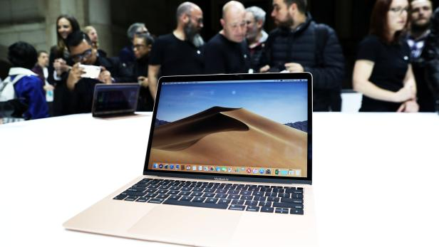 Attendees try out the new MacBook Air during an Apple launch event in the Brooklyn borough of New York