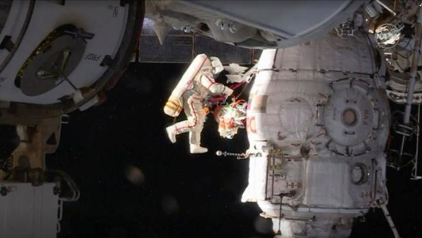 Russian cosmonaut Oleg Kononenko conducts a spacewalk outside the International Space Station Space (ISS) in this still image captured from NASA video in space