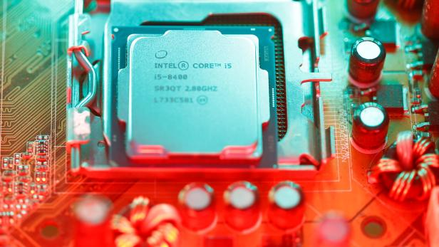 Intel's 8th generation Core i5 processor is seen on the computer's motherboard in this illustration