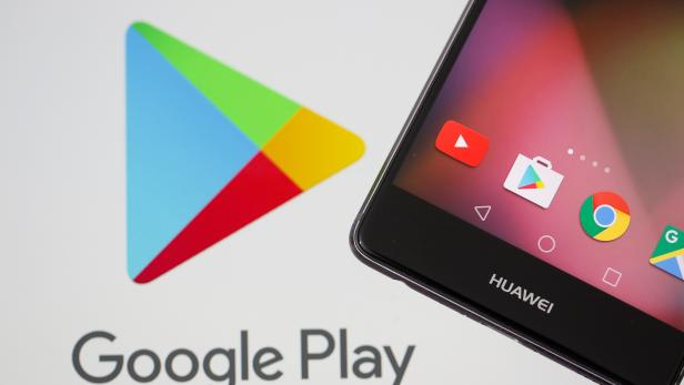 A Huawei smartphone is seen in front of displayed Google Play logo in this illustration picture