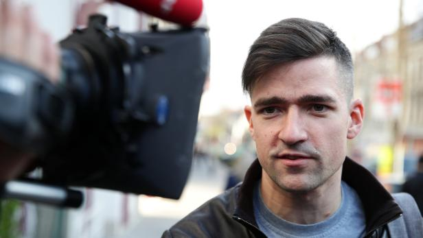 Martin Sellner, leader of Austria's far-right Identitarian Movement speaks to the media in Vienna