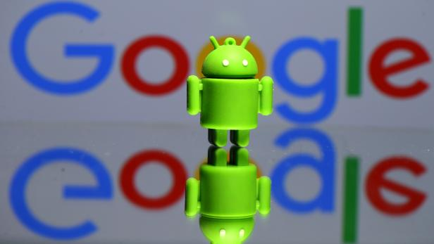 FILE PHOTO: A 3D printed Android mascot in front of a Google logo in this illustration