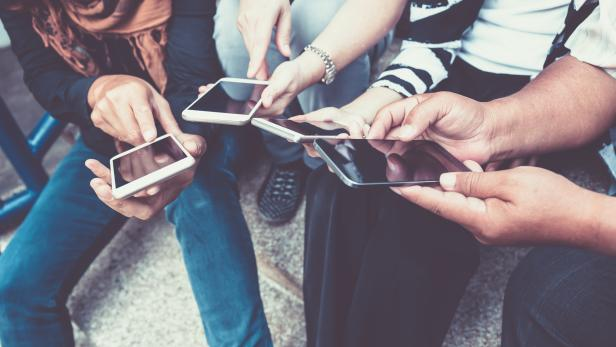 group of people using smart phone for online shopping or ecommerce concept