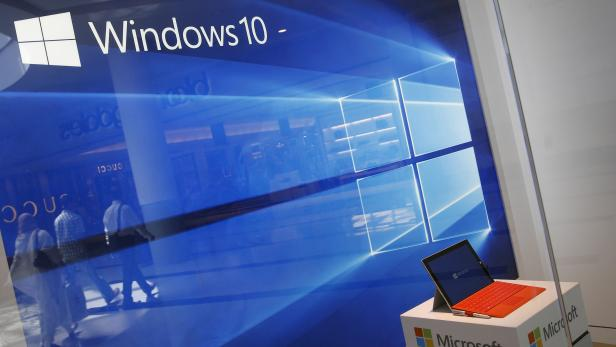 FILE PHOTO: A display for the Windows 10 operating system is seen in a store window of the Microsoft store at Roosevelt Field in Garden City