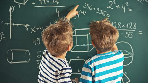Math is fun - little boys solving mathematical problems