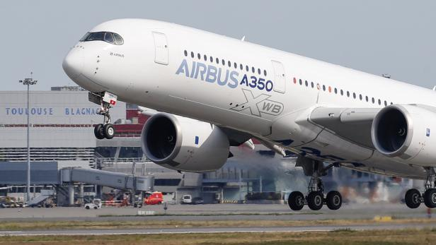 An Airbus A350 takes off at the aircraft builder's headquarters in Colomiers near Toulouse