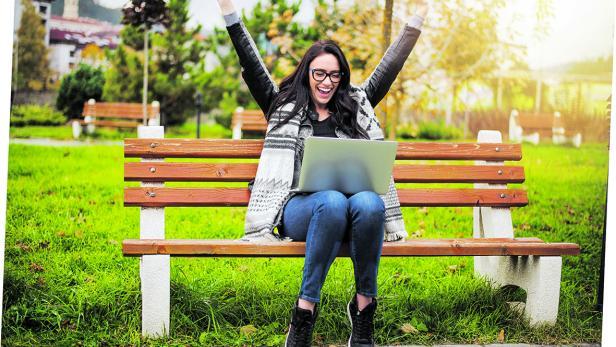 Euphoric winner watching a laptop