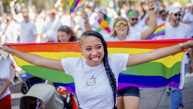 Apple retail employee Minh Phan marches in the San Francisco Gay Pride Festival in California