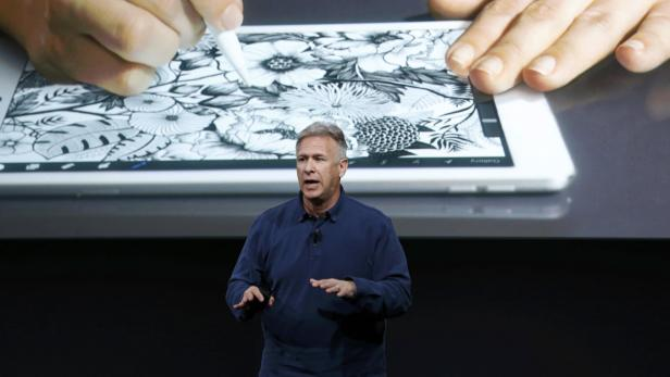 Phil Schiller, senior VP of worldwide marketing for Apple, introduces the iPad Pro with 9.7-inch display during an event at the Apple headquarters in Cupertino, California