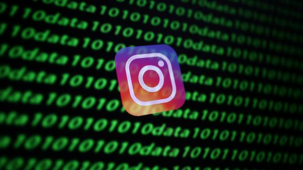 The Instagram logo and binary cyber codes are seen in this illustration