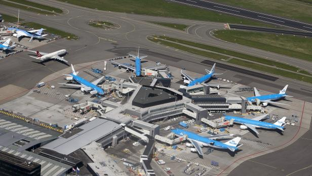 KLM aircrafts are seen on the tarmac at Schipol airport near Amsterdam