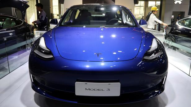 FILE PHOTO: China-made Tesla Model 3 electric vehicle is seen ahead of the Guangzhou auto show in Guangzhou