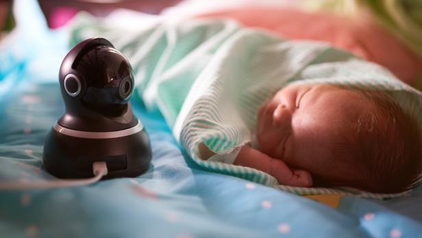 Dome camera watching sleeping baby