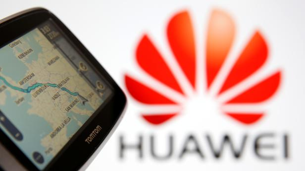 TomTom car navigation is seen in front of a Huawei logo
