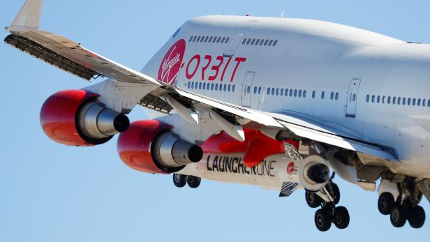 Richard Branson's Virgin Orbit, with a rocket underneath the wing of a modified Boeing 747 jetliner, takes off to for a key drop test of its high-altitude launch system for satellites from Mojave, California