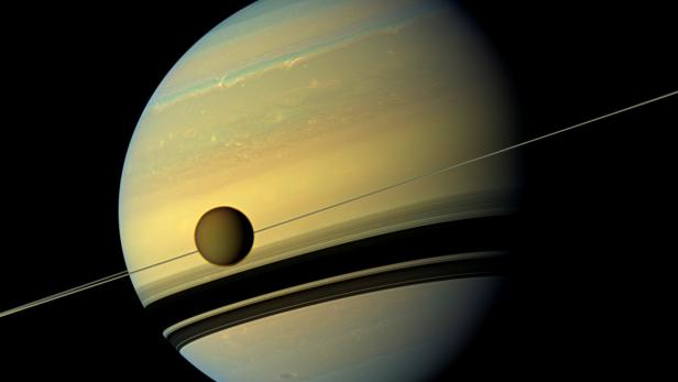 FILE PHOTO: Handout of Titan, Saturn's largest moon in this natural color view from NASA's Cassini spacecraft