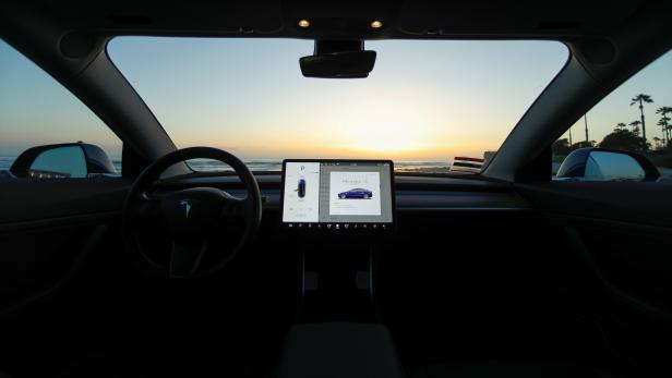 The interior of a 2018 Tesla Model 3 electric vehicle is shown in Cardiff