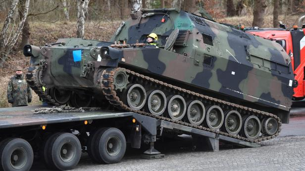 Soldiers of German Army Bundeswehr load a U.S. M992 support vehicle tank onto a heavy goods transporter during preparations for the Defender-Europe 20 international military exercises in Bergen Hohne