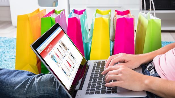 Woman Sitting On Carpet Using Laptop To Shop Online
