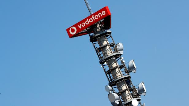 FILE PHOTO: Different types of 4G, 5G and data radio relay antennas for mobile phone networks on a relay mast operated by Vodafone
