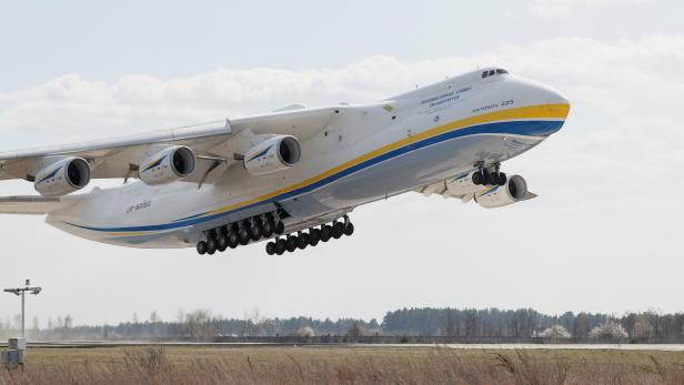 An Antonov An-225 Mriya cargo plane takes off from an airfield in Hostomel