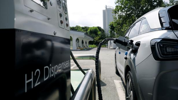 A Hyundai Motor's Nexo hydrogen car is fuelled at a hydrogen station in Seoul