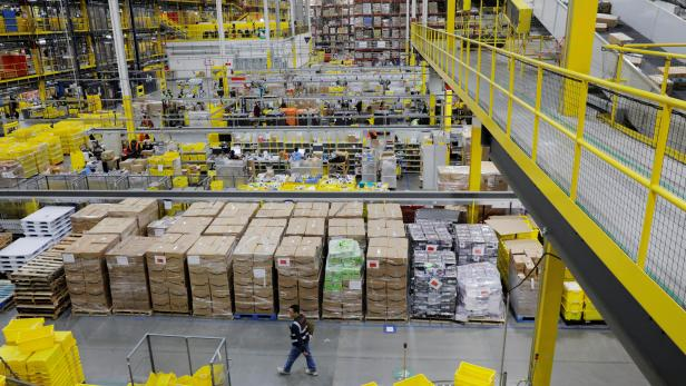 FILE PHOTO: Amazon workers perform their jobs inside of an Amazon fulfillment center on Cyber Monday in Robbinsville, New Jersey