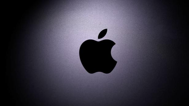 Apple logo is seen on the Macbook in this illustration taken