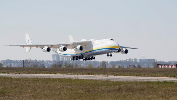 A cargo plane carrying medical equipment from China lands at an airfield outside Kiev