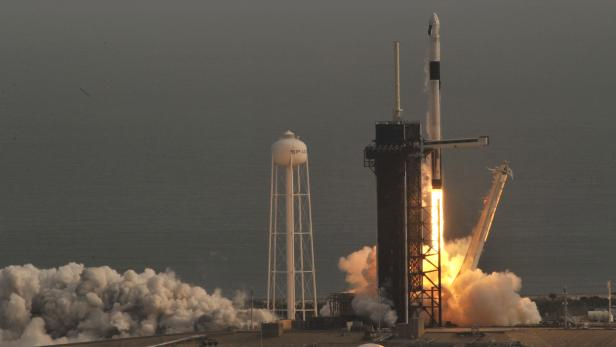 A SpaceX Falcon 9 rocket, carrying the Crew Dragon astronaut capsule, lifts off on an in-flight abort test from the Kennedy Space Center in Cape Canaveral