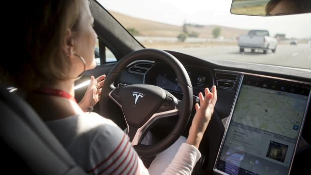 FILE PHOTO -New Autopilot features are demonstrated in a Tesla Model S during a Tesla event in Palo Alto, California