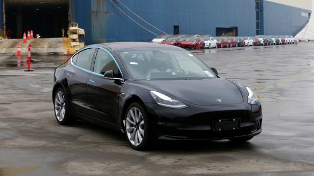 Tesla Model 3 car leaves a cargo vessel at a port in Shanghai
