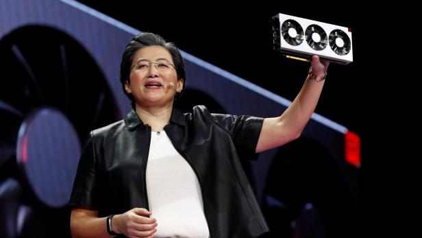 Lisa Su, president and CEO of AMD, holds up the Radeon VII, a 7nm gaming graphics card during a keynote address at the 2019 CES in Las Vegas
