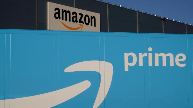 The logo of Amazon Prime Delivery is seen on the trailer of a truck outside the company logistics center in Lauwin-Planque